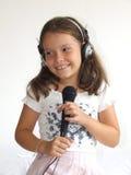La muchacha canta Foto de archivo libre de regalías