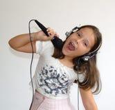 La muchacha canta Fotografía de archivo libre de regalías