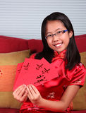 La muchacha celebra Año Nuevo chino Fotografía de archivo libre de regalías