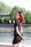 La muchacha cerca del canal Imagen de archivo libre de regalías
