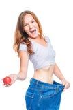 La muchacha chocada es feliz con el resultado de una dieta de la manzana en una pizca Fotos de archivo