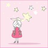 La muchacha cogió la estrella el caer Fotografía de archivo libre de regalías