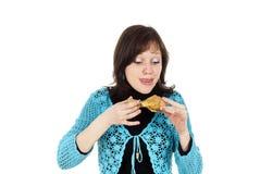 La muchacha come un pollo Imagen de archivo