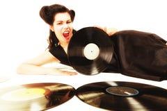 La muchacha con análogo del phonography registra al amante de la música Foto de archivo