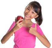 La muchacha con Apple y los pulgares suben la muestra V Imagen de archivo