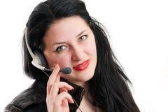La muchacha con auriculares y un micrófono Foto de archivo libre de regalías