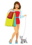La muchacha con compras y un perrito Imagenes de archivo