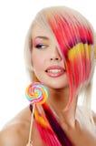 La muchacha con el caramelo de azúcar Fotos de archivo
