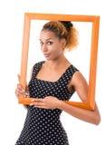 La muchacha con el marco de la imagen Imagen de archivo
