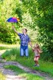 La muchacha con el padre Fotografía de archivo libre de regalías