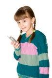 La muchacha con el teléfono celular Fotografía de archivo libre de regalías
