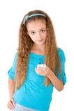 La muchacha con el teléfono móvil Imágenes de archivo libres de regalías