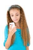 La muchacha con el teléfono móvil Fotos de archivo libres de regalías
