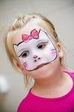 La muchacha con la cara pintó Fotos de archivo libres de regalías