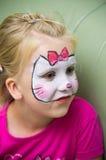 La muchacha con la cara pintó Imágenes de archivo libres de regalías