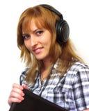 La muchacha con la computadora portátil Imagen de archivo libre de regalías