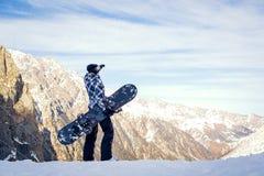 La muchacha con la snowboard Fotos de archivo libres de regalías