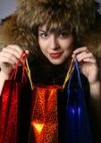 La muchacha con las compras. Fotos de archivo libres de regalías