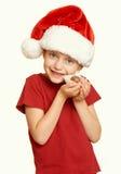 La muchacha con las galletas para santa, concepto de la Navidad de las vacaciones de invierno, amarillea entonado Imágenes de archivo libres de regalías
