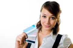 La muchacha con las tarjetas de crédito Foto de archivo libre de regalías