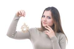 La muchacha con los christmass juega en su mano Imagen de archivo