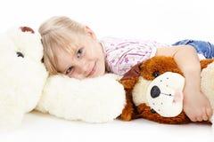 La muchacha con los juguetes Foto de archivo libre de regalías