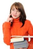 La muchacha con los libros, refleja Fotografía de archivo libre de regalías