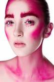 La muchacha con rosa creativo compone Foto de archivo