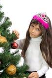 La muchacha con un árbol del Año Nuevo Imagenes de archivo