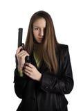 La muchacha con un arma Imagenes de archivo