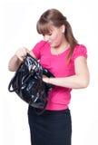 La muchacha con un bolso en manos Foto de archivo