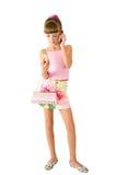 La muchacha con un bolso rosado Foto de archivo