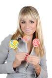 La muchacha con un caramelo de azúcar Imágenes de archivo libres de regalías