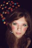 La muchacha con un maquillaje brillante Imagen de archivo libre de regalías