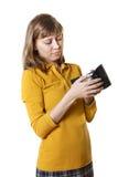 La muchacha con un monedero Imagen de archivo