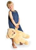 La muchacha con un oso de peluche grande Imagenes de archivo
