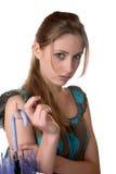 La muchacha con un paraguas aislado en blanco Imágenes de archivo libres de regalías