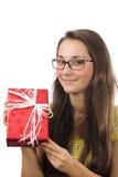 La muchacha con un regalo Foto de archivo libre de regalías