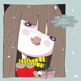 ¡La muchacha con un regalo a disposición y la Feliz Navidad de las palabras! Imagenes de archivo
