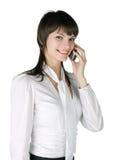 La muchacha con un teléfono Imagenes de archivo