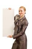 La muchacha con una hoja limpia del papel Foto de archivo