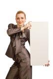 La muchacha con una hoja limpia del papel Fotografía de archivo