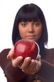 La muchacha con una manzana Fotos de archivo