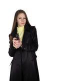 La muchacha con una pistola Imagen de archivo