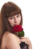 La muchacha con una rosa en un fondo blanco Fotos de archivo