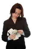 La muchacha considera el dinero Imagen de archivo