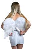 La muchacha cortó las alas blancas del ángel Fotografía de archivo