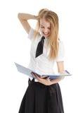 La muchacha dada una sacudida eléctrica mira en una carpeta Fotografía de archivo libre de regalías