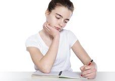 La muchacha de Eenage está haciendo su preparación Foto de archivo libre de regalías