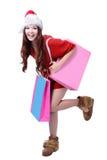 La muchacha de la belleza toma el bolso de compras en blanco rosado Imagen de archivo libre de regalías